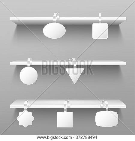 Wobblers On Wooden Shelves. Blank Price Tags Hang On Rack On Grey Wall Background. Paper Stickers On