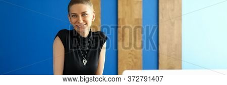 Portrait Of Attractive Young Woman Posing In Personal Office. Smiling Cheerful Female Wearing Long B
