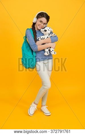 Diverse Learning Environments Designed To Meet The Needs. Teen With Backpack. Cute Smiling Schoolgir