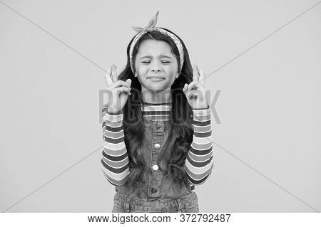 Make A Wish. Retro Girl Crossed Fingers. Please. Wait Impatiently. Little Child Yellow Wall. Old Fas