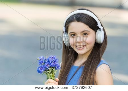 Baby Headphones. Happy Child Wear Headphones Outdoors. Small Girl Listen To Music In Headphones. Noi