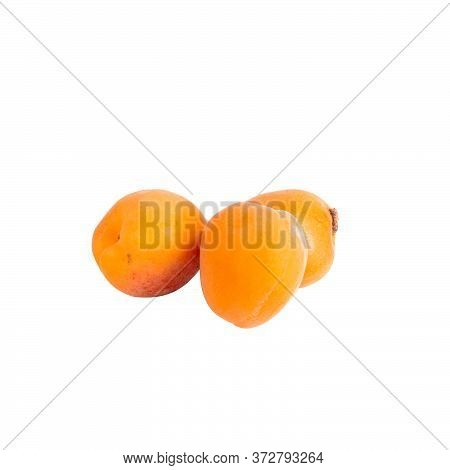 Few Whole Ripe Orange Apricots Isolated On White Background