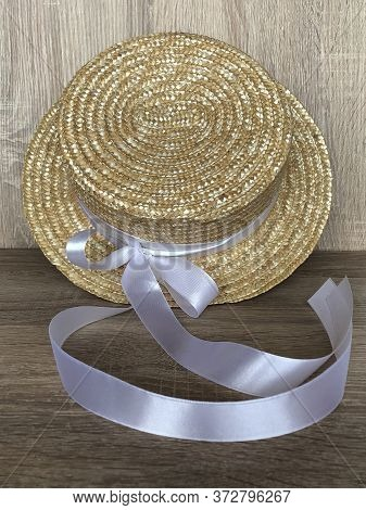 Canotier Hat With A White Bow. Straw Hat With A White Satin Ribbon. Straw Texture.    Hand Made Hat.