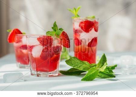 Glass Of Strawberry Soda Drink On Light Blue Background. Summer Healthy Detox Lemonade, Cocktail Or