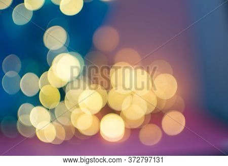 Abstract Yellow Bokeh Circles On Blurred Background