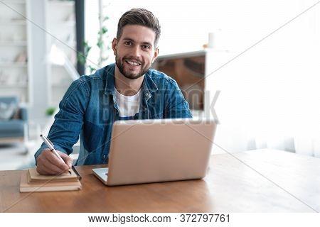 Handsome Modern Man Designer Working On Laptop Online, Using Internet At Home