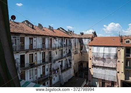 Turin, Piemonte, Italy. June 2020. View On The Facade Of A House In The Historic District Of Vanchig