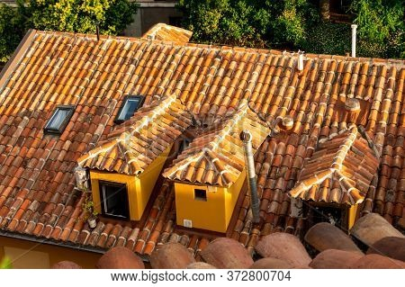City View Of Rooftop In Summer. Panoramic Views And Rooftops, Roof Tiles. Sunset