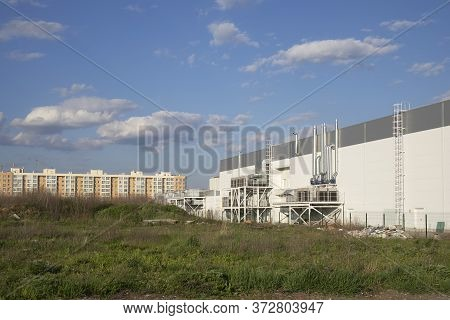 Industrial District Near The Living Houses Against Blue Sky. Environmental Conditions