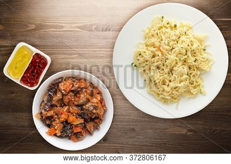 Vermicelli On A White Plate On Brown Wooden Background. Vermicelli On A Plate With Vegetarion Salad