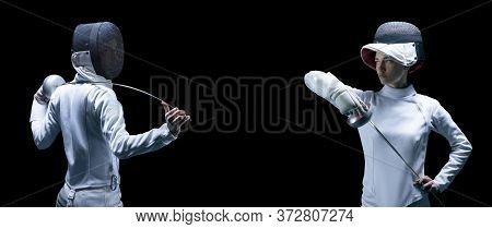 Portrait Of Two Fencers On A Black Background. The Concept Of Fencing. Duel.