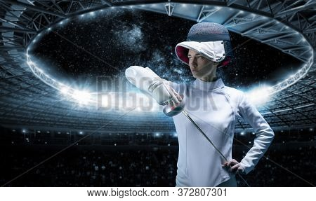 Portrait Of A Fencer Against The Backdrop Of A Sports Arena. The Concept Of Fencing. Mixed Media