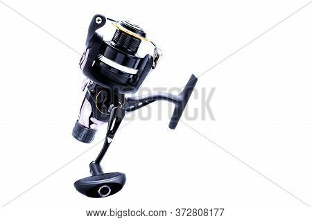 Fishing Reel Upright. Fishing Reel In Black. Isolate. Copy Space.