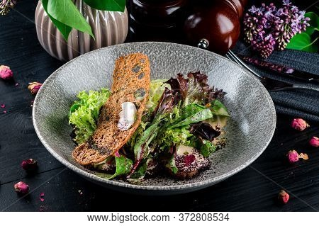 Delicious Food: Slow Cooked Pulled Beef With Fresh Vegetable Salad Close-up On A Plate. Fresh Pork S