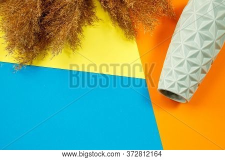 A Minimalistic Composition Of A Light Turquoise Ceramic Vase, Lies An Empty Vase On A Colored Backgr