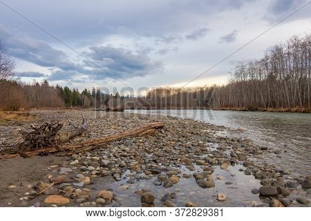 Beautiful Spring Sunset On A Glacial Green River In British Columbia, Canada.