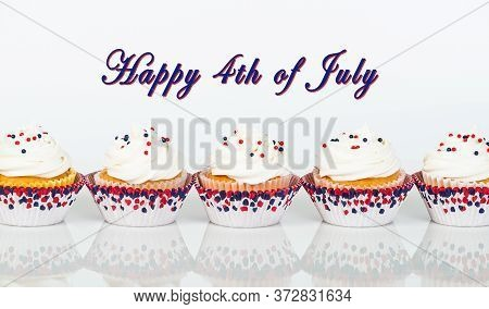 Row Of Patriotic Fourth Of July Celebration Cupcakes With Red, White, And Blue Theme Sprinkles. Happ