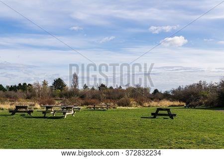 Picnic Tables On Green Lawn In Beautiful Terra Nova Rural Park Richmond British Columbia During Spri