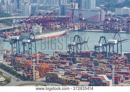 Container Ship In Cargo Port In Hong Kong City