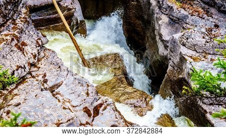 The Turbulent Waters Of The Maligne Canyon Flowing Through The Deep Maligne Canyon In Jasper Nationa