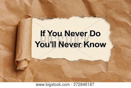 Text If You Never Do You'll Never Know Appearing Behind Torn Brown Paper