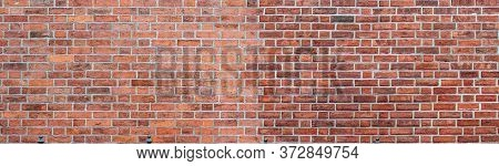 Panorama Of Large Red Brick Wall With White Grouting. Textured Old Vintage Brick Background.
