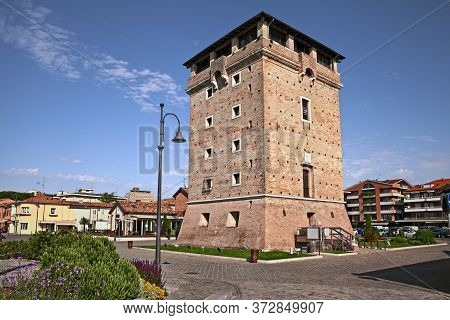 Cervia, Ravenna, Emilia-romagna, Italy: The Ancient Defensive Saint Michael Tower On The Canal Port