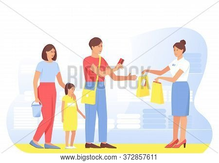 The Family Makes Purchases From The Seller In The Store. Dad Pays With A Card For The Purchase, Mom