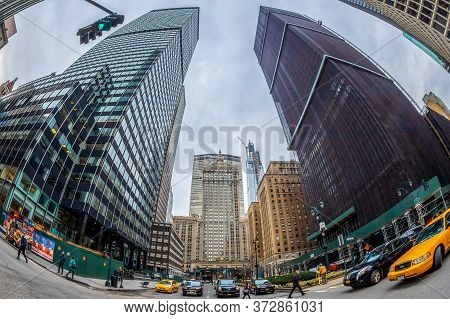 New York, Manhattan - March 6, 2020: Buildings And Traffic In Manhattan With Typical Yellow Taxi See