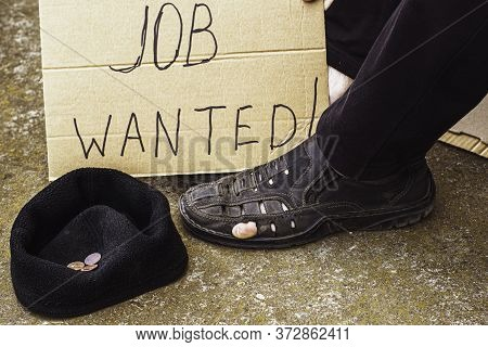 Unemployment Concept Man In Old Torn Shoes Sits On A Ground At His Feet Cardboard Sign Saying Job Wa