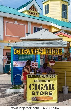 Nassau, Bahamas - May 3, 2019: People In Front Of A Cigar Store In Nassau, New Providence, Bahamas.