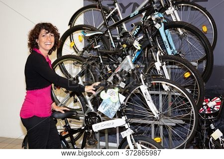 chooses bicycle in bikes sports store department of hypermarket in france