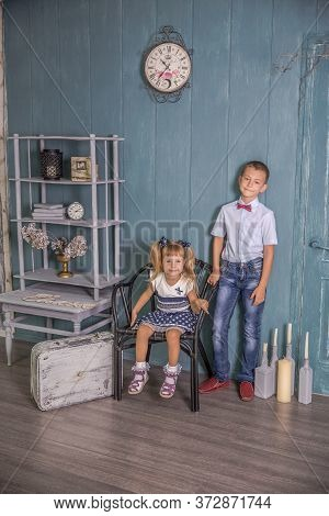Two Caucasian Siblings Brother And Sister Posing. Girl And Boy At A Photo Shoot
