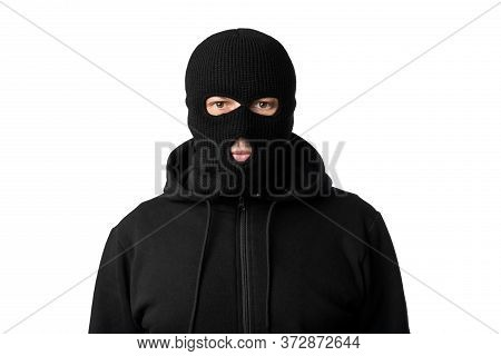 Riots, Robbery And Marauding Concept. Portrait Of Disguised Villain In Black Mask Posing At Camera O