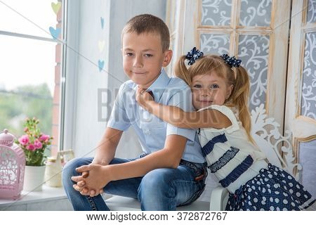 Two Caucasian Siblings Brother And Sister Posing. Girl And Boy At Photo Shoot
