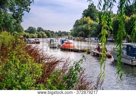 Thames Riverfront With Many Boats In Richmond, London, Uk.