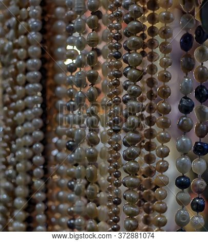 Multicolored Pearl Beads On The Market Close Up