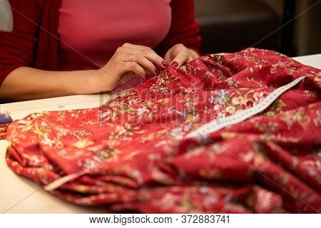Tailor Woman Sews Red Dress. Tailor Working In Her Tailor Shop