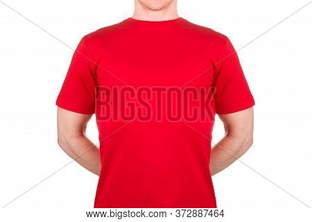 Man In Red T-shirt Hiding Something Behind His Back Isolated On White