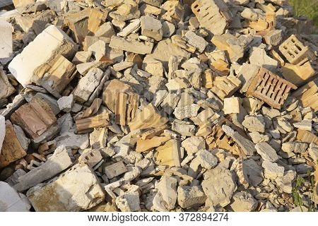 A Pile Of Used Red Bricks Close Up