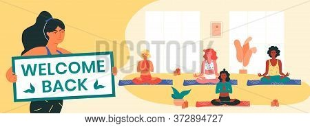 Yoga Instructor Holds Welcome Back Banner, Informing Her Clients About The Resumption Of Yoga Classe