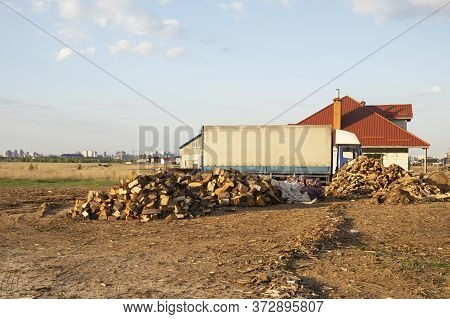 Pile Of Chopped Dry Firewoods Outdoors Near House