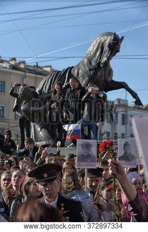 Russia, St. Petersburg 05/09/2015 Immortal Regiment On Nevsky Prospekt On Victory Day
