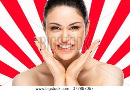 Cheerful Beautiful Woman Face Portrait Close Up Over Red And White Geometric Background. Beauty Skin