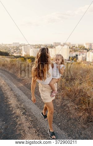Joyfull Young Mother Spend Wonderful Holiday Time In The Forest With Her Kid. Two Blondies, Mother A