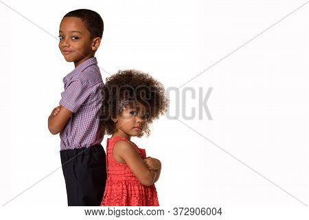 Childhood And People Concept-two African American Siblings Standing Back To Back With Arms Crossed,