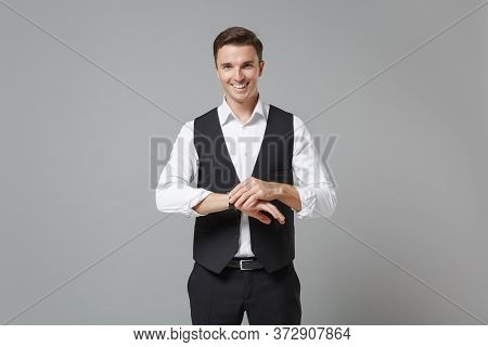 Confident Young Business Man In Classic Black Waistcoat Shirt Posing Isolated On Grey Wall Backgroun
