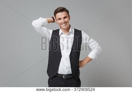 Funny Young Business Man In Classic Black Waistcoat Shirt Posing Isolated On Grey Wall Background St