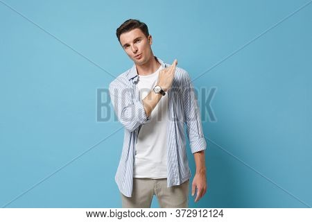 Confident Young Man Guy 20s In Casual Clothes Posing Isolated On Pastel Blue Background Studio Portr