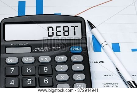 Word Debt On Calculator. Business And Tax Concept. Stock Photo